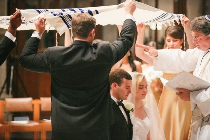 The Rev. Ken Howard, a Jewish Christian and an Episcopal priest, blesses Elena Taube (another Jewish Christian) and Paul Bailey under an improvized huppah at the Washington National Cathedral.